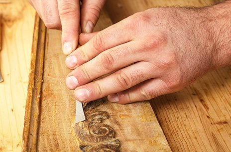 Skilled craftsman using a wood chisel