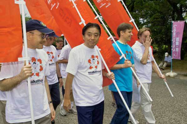 Mayor carrying sponsor flag at 2009 Walkathon in Nagoya