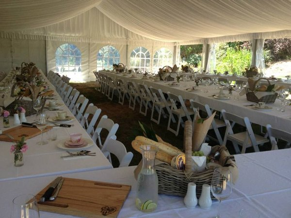 long line of white chairs and tables