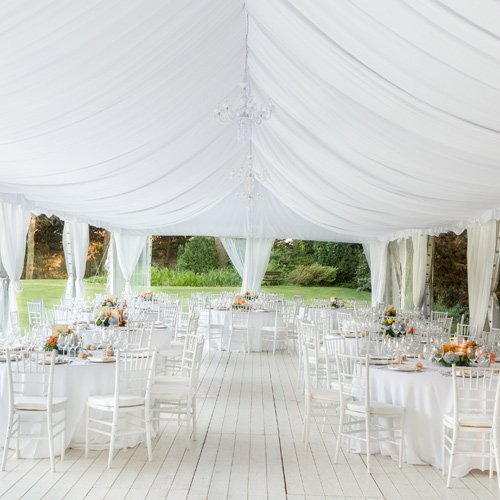 large white tent over table setups