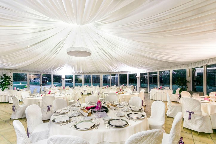white decorated chairs for a celebration