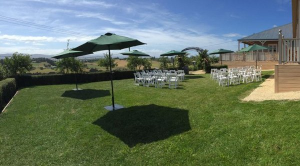 outdoor set up with chairs and large green covers