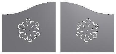 un cancello in ferro con dei disegni a fiori