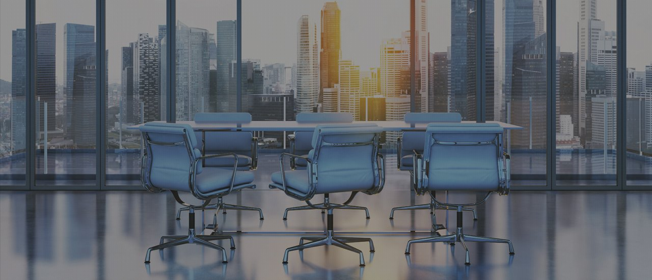 Aqua coloured office chairs around a meeting room table