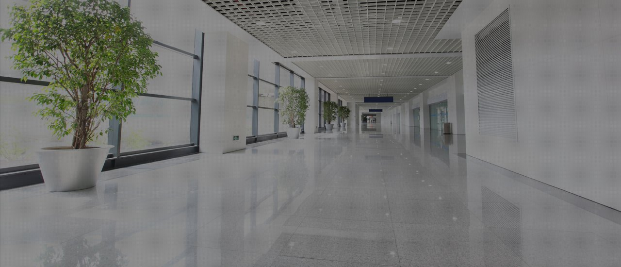 Long white corridor with tiled floor