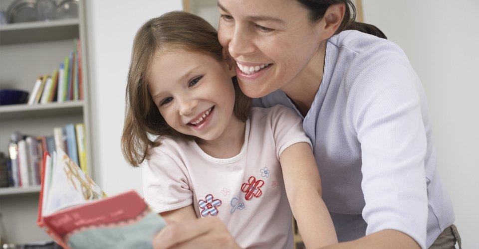 A nanny reading story to a child