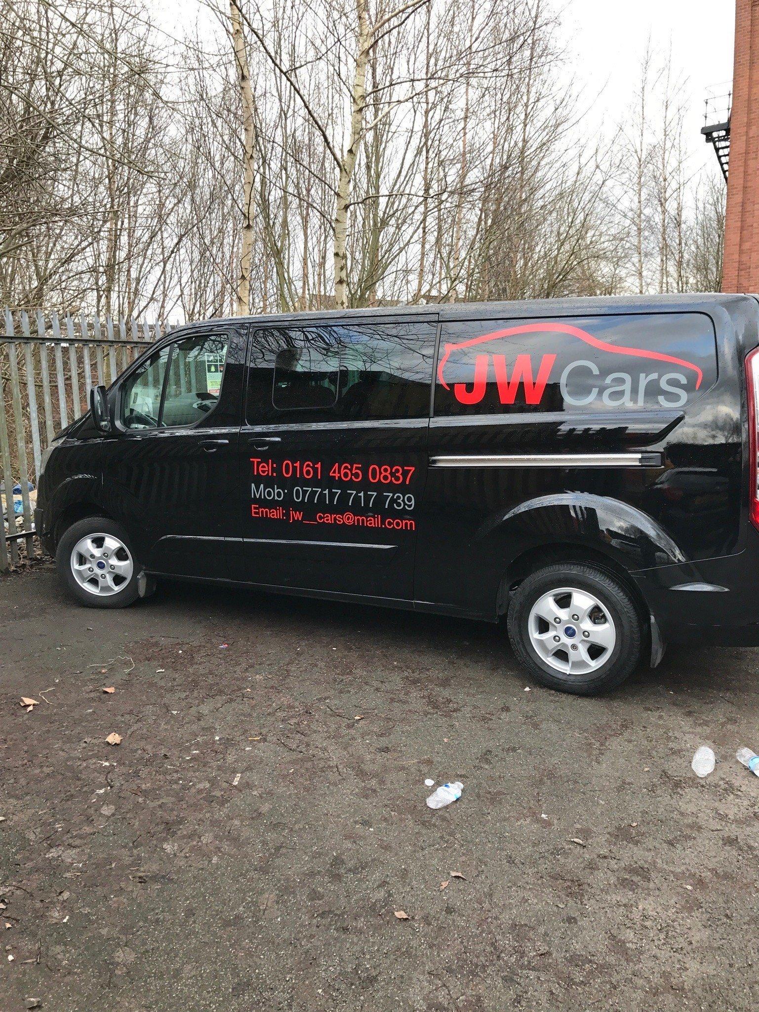 Black Van With Red & Grey Van Signs -Manchester