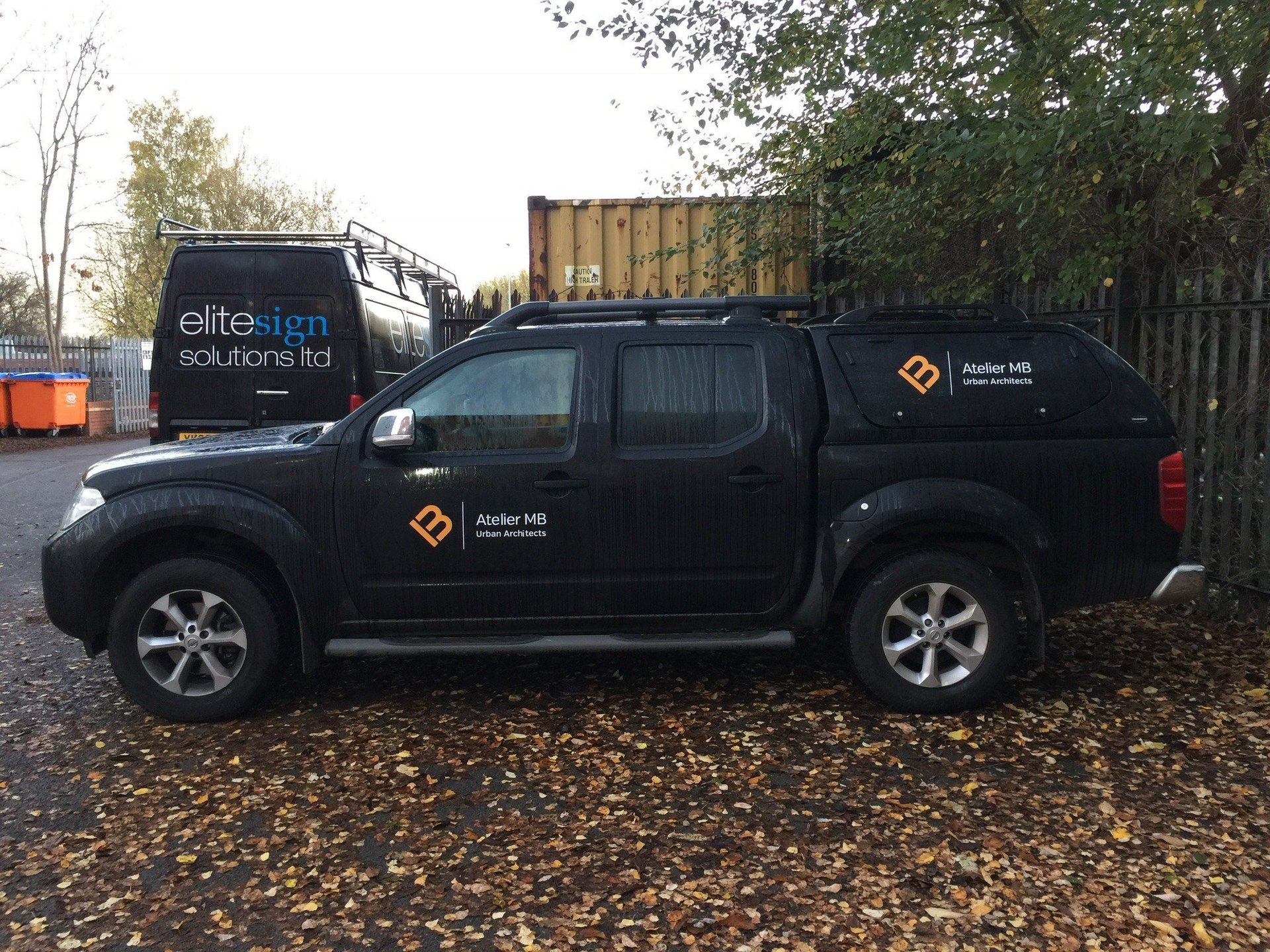 Black Pick Up Truck With Company Branded Signs in Manchester