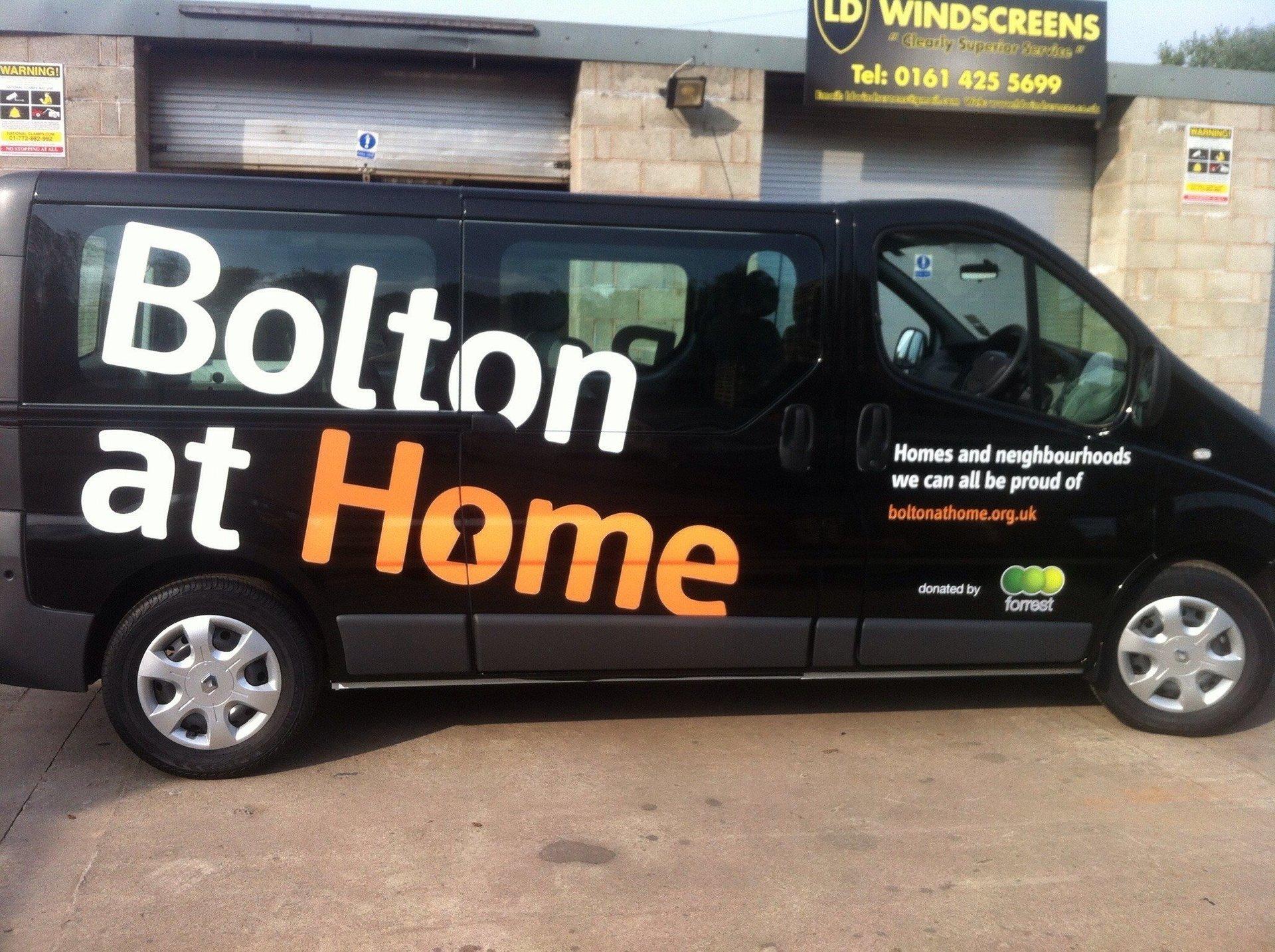 Black Van With White & Orange Van Signs - Manchester