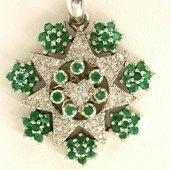 presentosa in oro bianco con smeraldi e brillanti