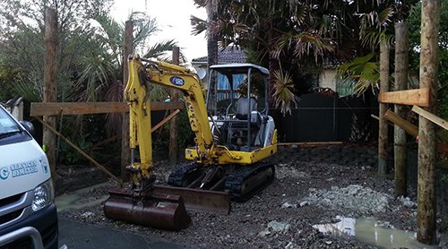 Machine being used for clearing the project site