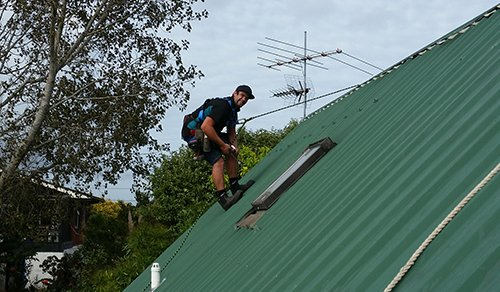 Specialist doing the repair work on roof