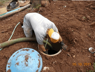 Gecko Enterprises employee working in septic dig hole