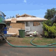 Septic hose going from Gecko Enterprise truck to residence