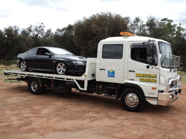 Towing a black sports car