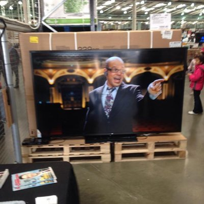 TV mounted on wooden plank