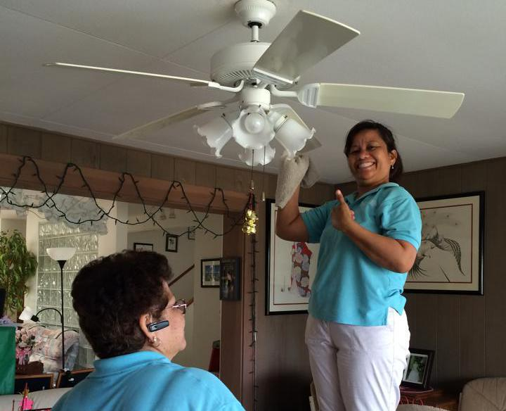 Cleaning ceiling fan in Honolulu Home