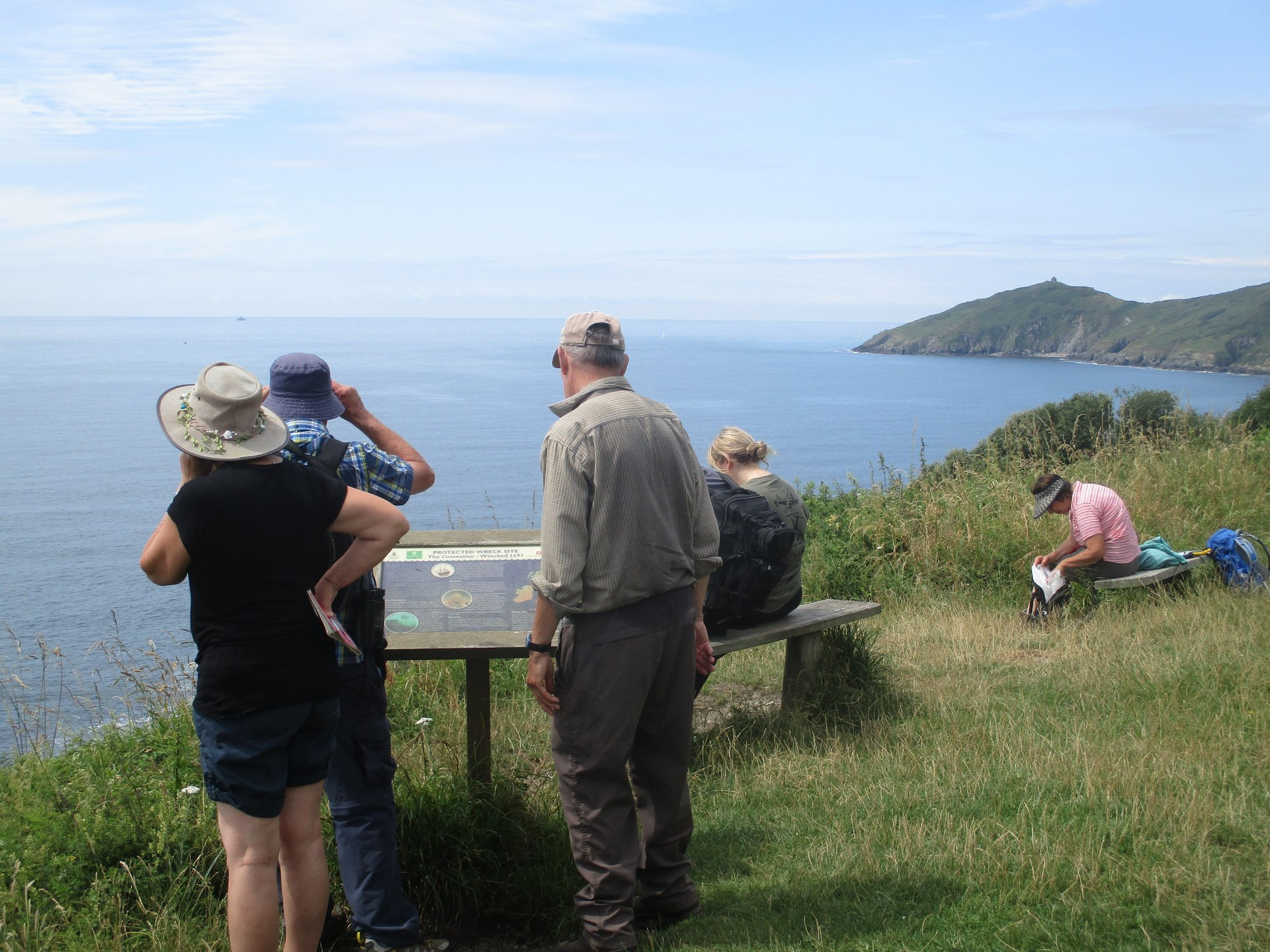 Hikers overlooking the South West Coast Path