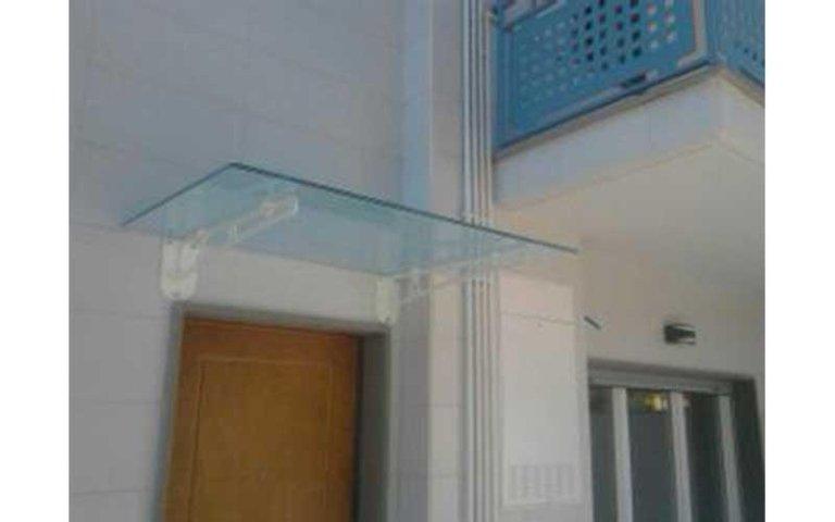 tettoia porta in vetro