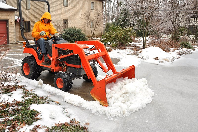 Man clearing the snow with machine