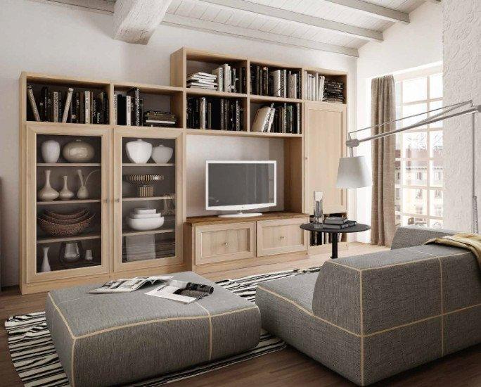 uno studio con una libreria in legno di color nero e due divani di pelle
