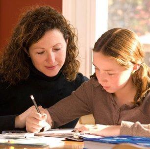 tutor helping the child write