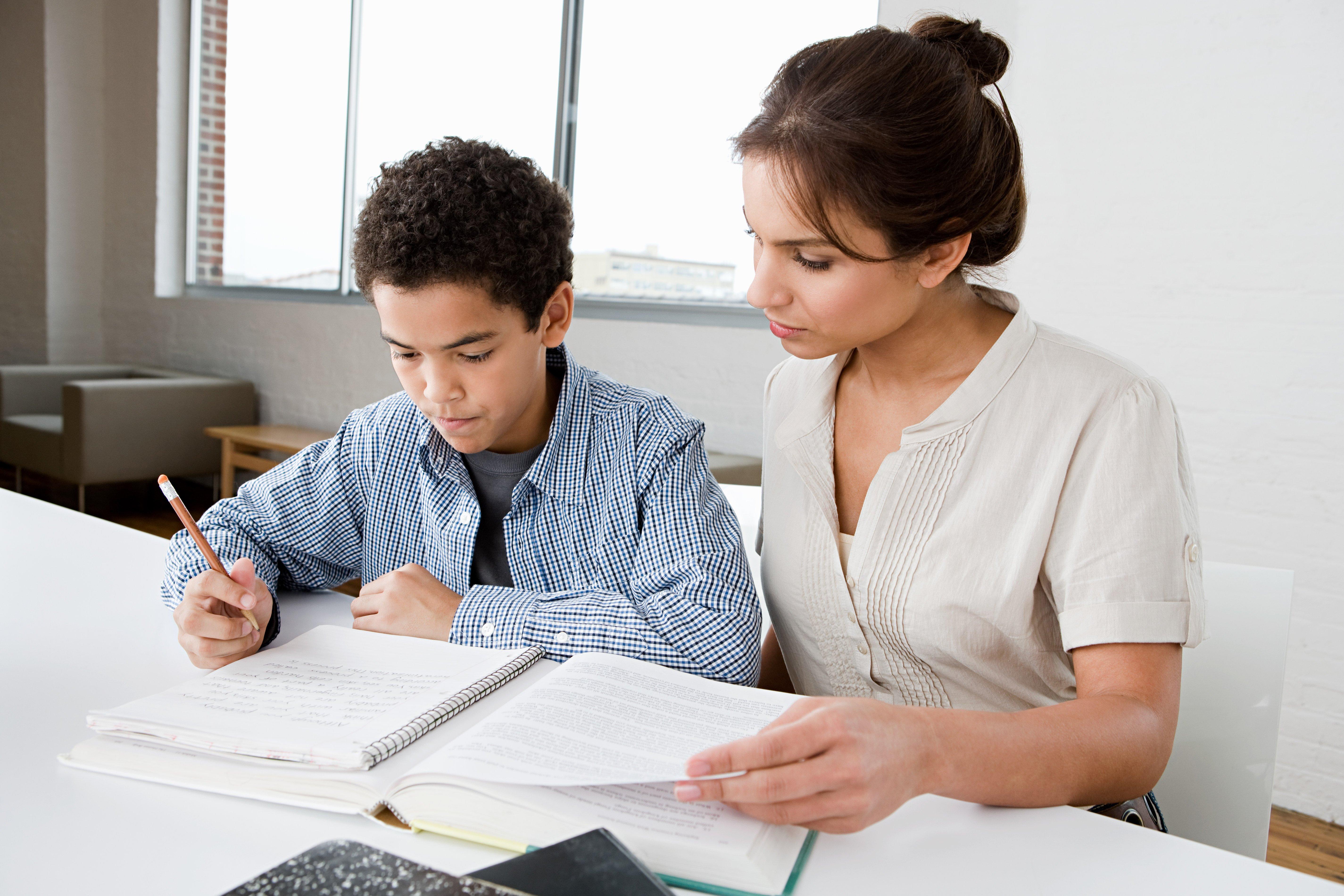 tutor monitoring the student