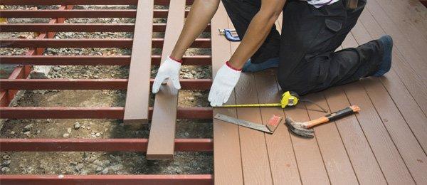 progressive renovations worker renovates deck