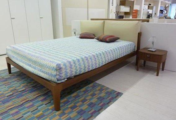 camera da letto con arredamento -vista angolare