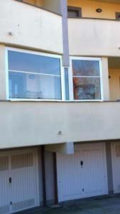balcone palazzo con chiusura invernale