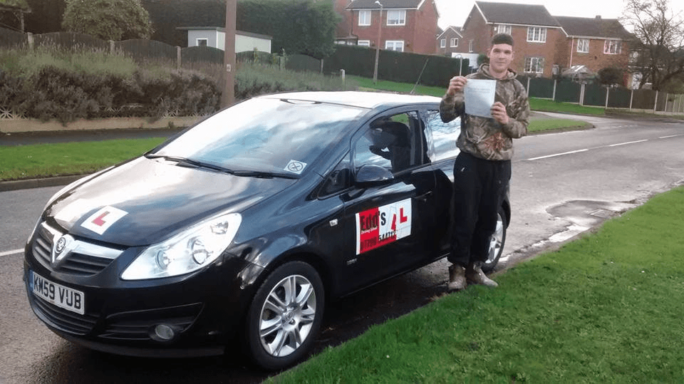 holding the driving test pass certificate
