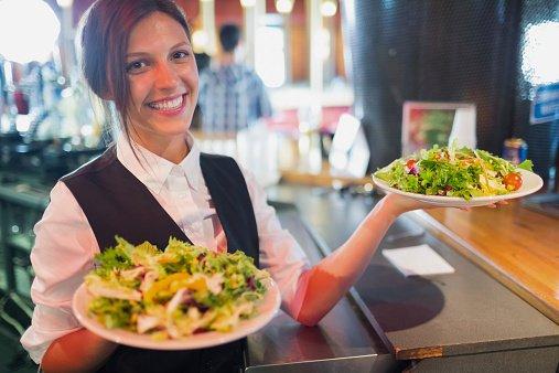waitress serving salad