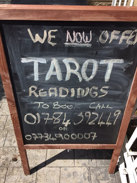 blackboard with tarot poster on it