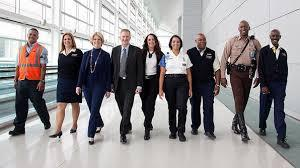 workers at airport after mindfulness course by wise blue owl therapy centre