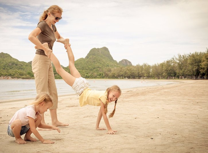 Woman playing with children to to relieve stress and anxiety with children