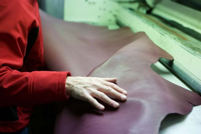 Hand caressing leather