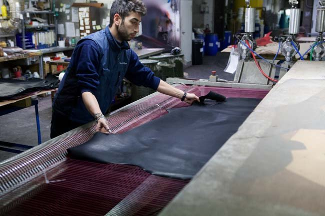 Person treating leather