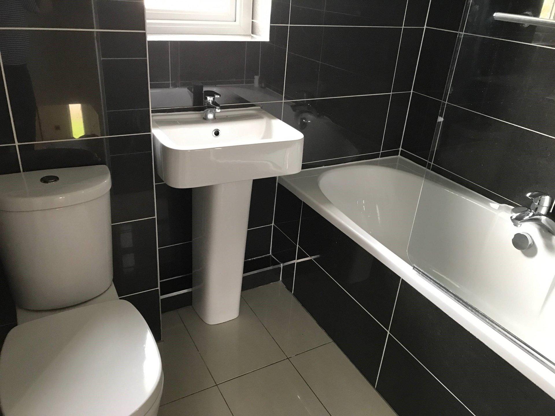 black coloured bathroom tiles