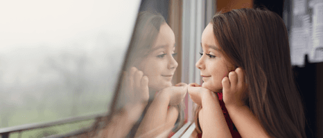 child looking outside the window