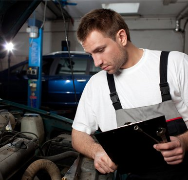 premier automotive mechanic checking car service