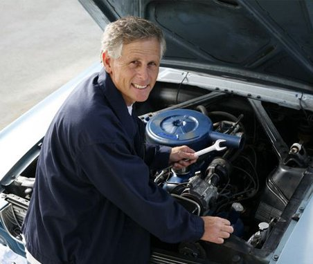 premier automotive mechanic repairing engine