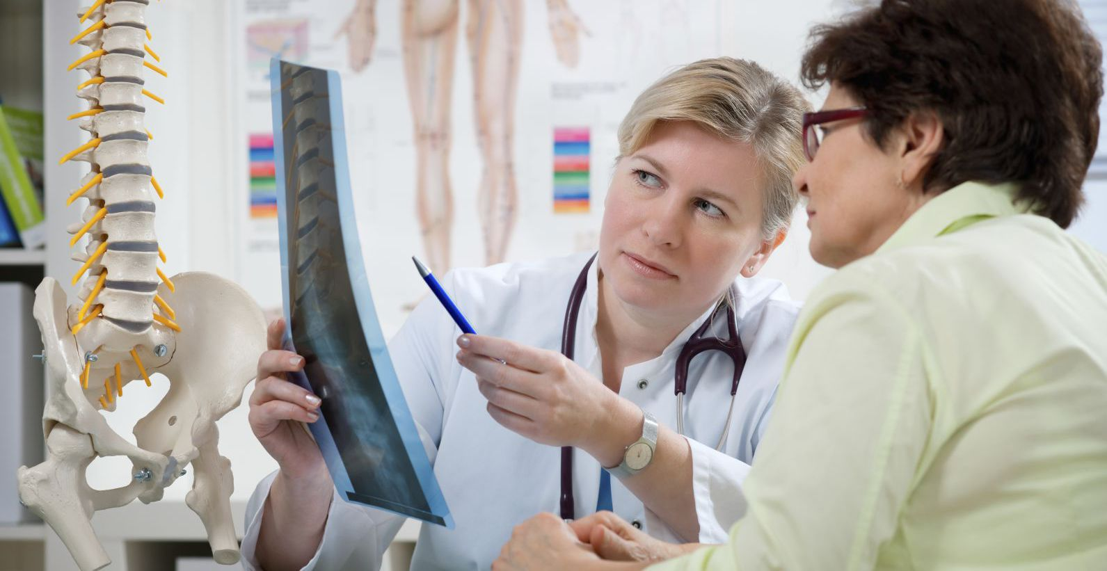 Woman consulting a chiropractor in Rochester, NY