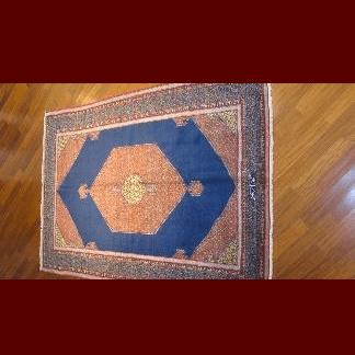 tappeto persiano blu e arancione