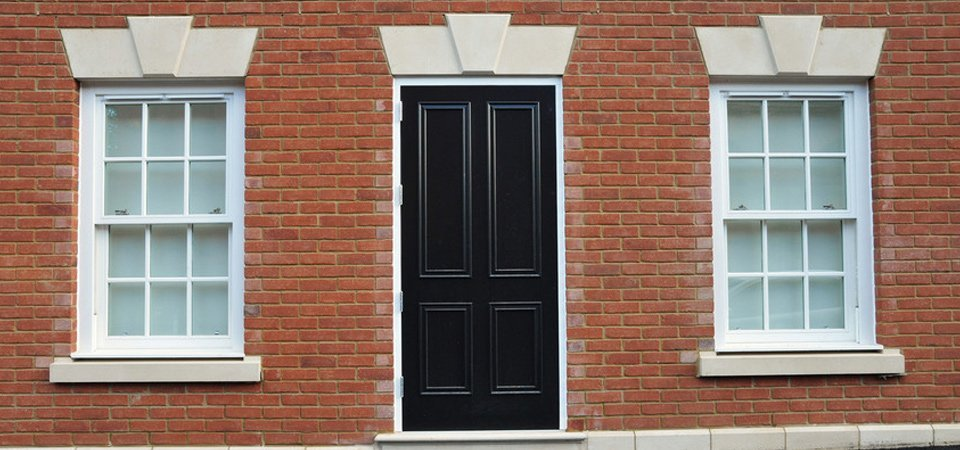 white frame windows and black door