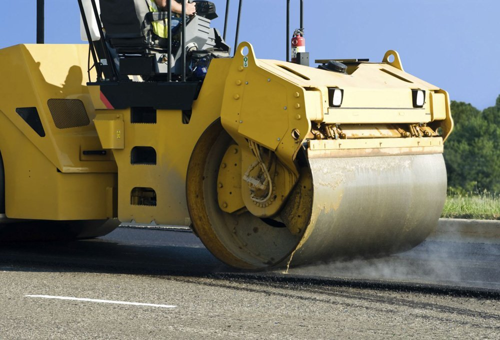 Machine being used for paving in west Virginia