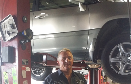The experts in brake service inspecting a car in High Point, NC