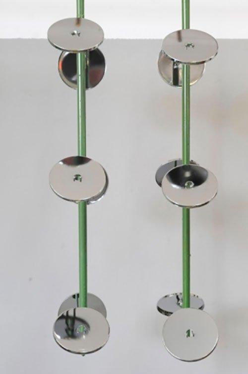 puleggie inserite in un tubo di ferro color verde
