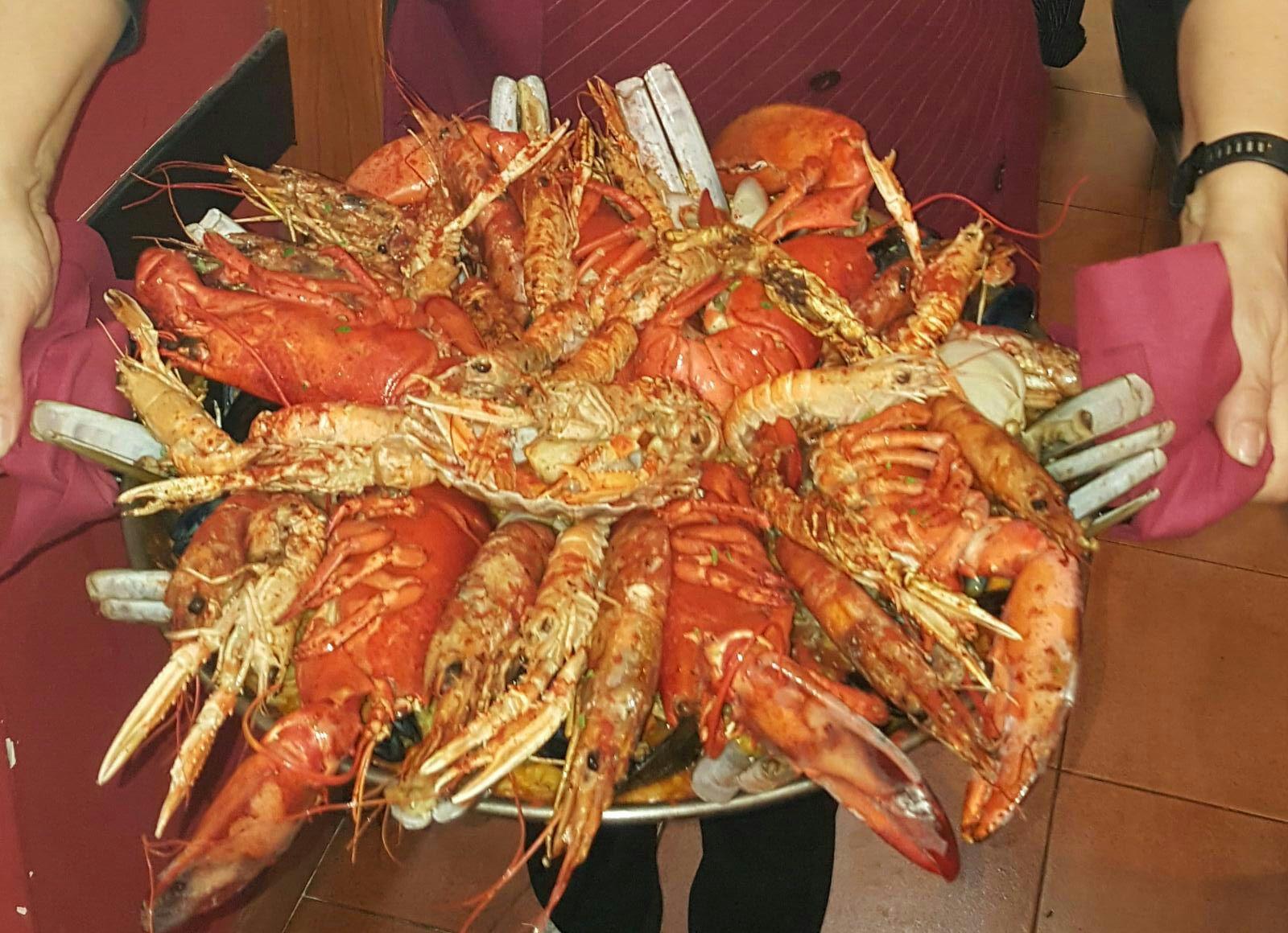 RIso con frutti di mari -  (gamberi,scampi, roncoli di mare, astice,cozze e vongole)