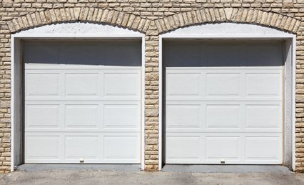 Roller and sectional garage door installations in plymouth for Plymouth garage doors