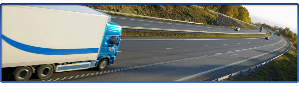 White and blue delivery van on a motorway